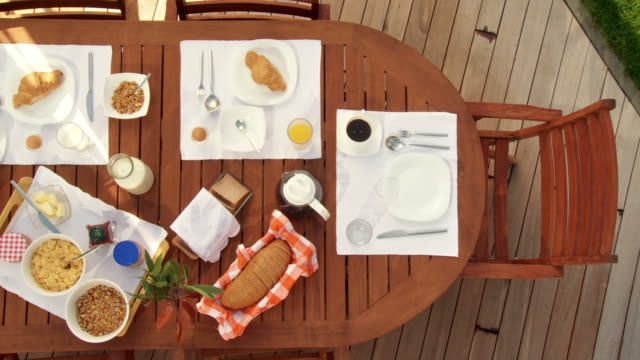 hd crane: breakfast table on the terrace - patio stock videos & royalty-free footage
