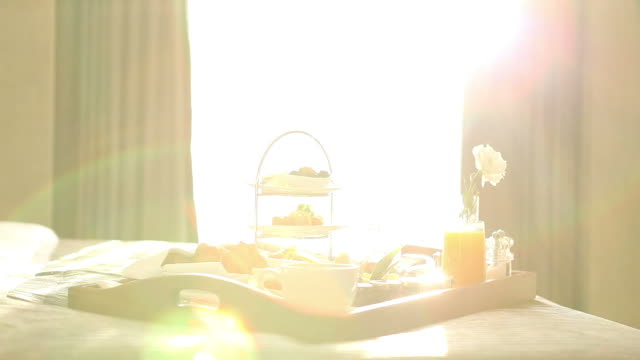 breakfast tray on bed - hotel stock videos & royalty-free footage