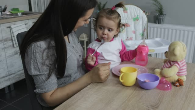 breakfast with baby daughter - one parent stock videos & royalty-free footage
