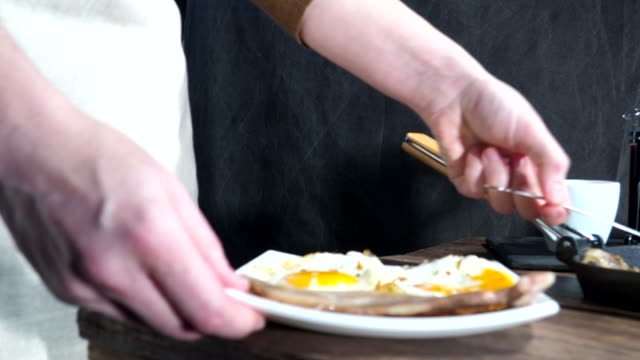 Breakfast with fried eggs, bacon and coffee