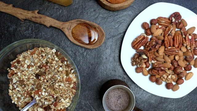breakfast with homemade granola - recipe stock videos & royalty-free footage