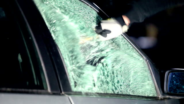 breaking car window - thief stock videos & royalty-free footage