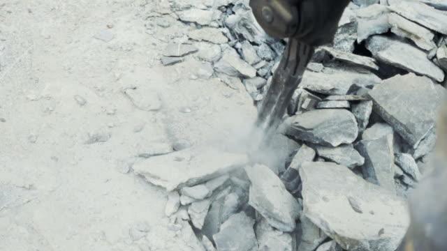 Breaking concrete.