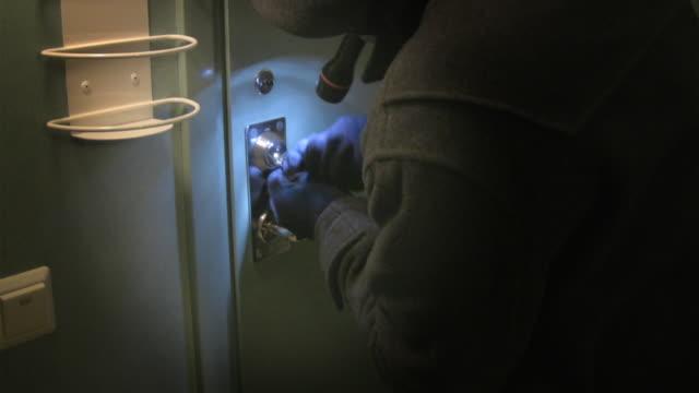 breaking in - burglar stock videos & royalty-free footage