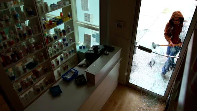 breaking retail store glass door - thief stock videos & royalty-free footage