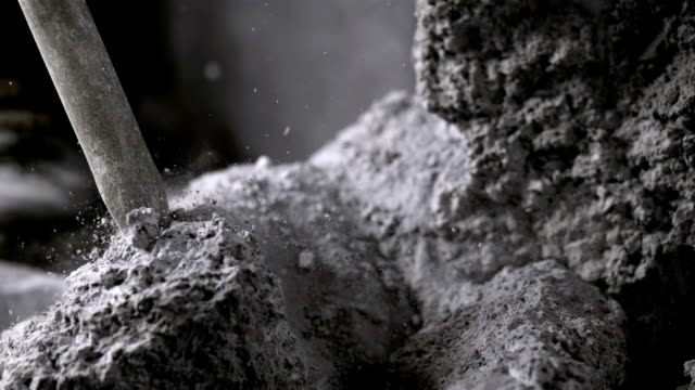 breaking up rock with a jackhammer (super slow motion) - stone material stock videos & royalty-free footage