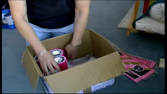 alison freund placing collection boxes to raise money to fight breast cancer into box tilt freund cs breast cancer campaign logo on tshirt tshirt... - little girl smoking cigarette stock videos and b-roll footage