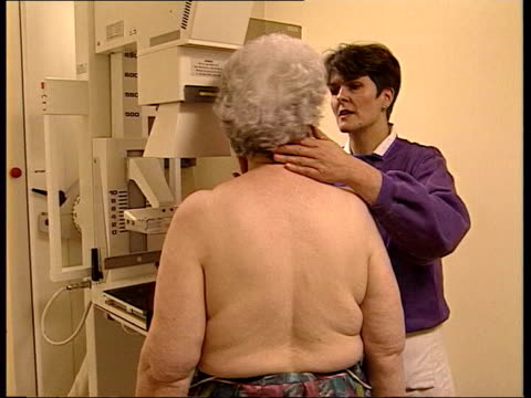 new findings lib elderly woman having mammogram bv doctor holding xrays up to lightbox - lightbox stock videos & royalty-free footage