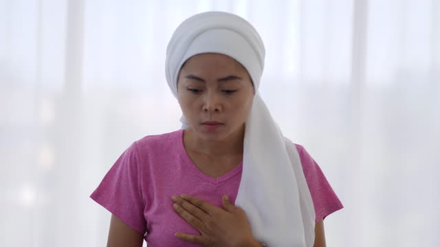 breast cancer patients press their chest with pain - bumpy stock videos & royalty-free footage