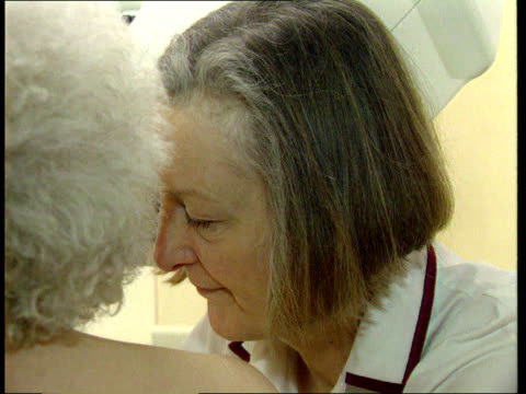 Breast cancer screening for young women works LIBTX 4299/HEALTH UNIT CLIPREEL Older woman having mammogram LIB People sitting at microscope PAN CS...