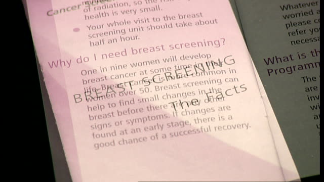 Breast cancer screening programme may lead to overdiagnosis Close shots of NHS Breast Screening pamphlet Colchester EXT Thornton cycling down street...