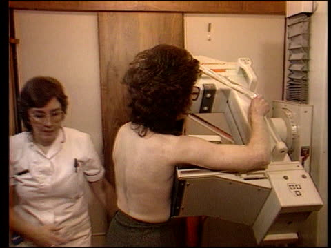 vídeos y material grabado en eventos de stock de self examination; itn lib st barts cbv woman being examined on breast scanner - territorios franceses de ultramar