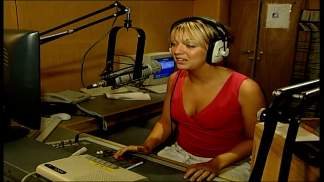 woman at risk decides to have mastectomy; itn england: chesterfield: int measures speaking into studio microphone as broadcasting local radio... - audio hardware stock videos & royalty-free footage