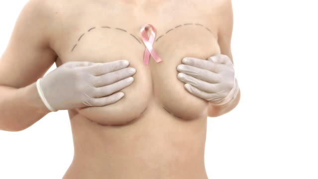 hd dolly: breast cancer's pink ribbon - breast augmentation stock videos and b-roll footage