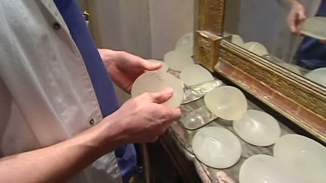 breast implants at the centre of a scandal over safety have been found to be twice as likely to rupture than other products but are not believed to... - breast augmentation stock videos and b-roll footage