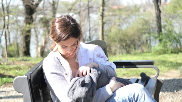 breastfeeding in public - breastfeeding stock videos & royalty-free footage
