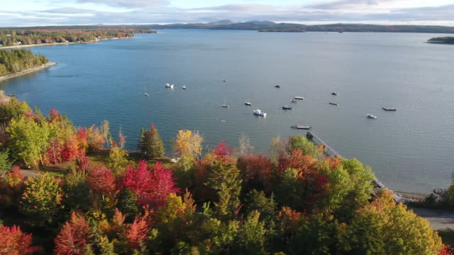 vidéos et rushes de a breathtaking aerial view of small town america in hancock, maine, usa - maine