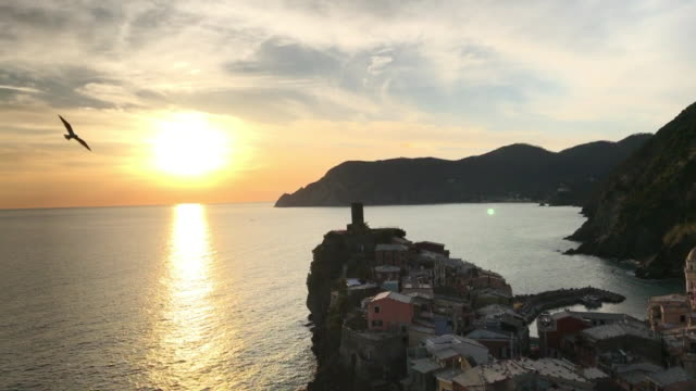 Breathtaking sunset in Vernazza. A photographer taking picture