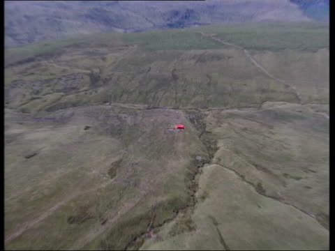 Brecon Beacons EXT AIR VIEW Tent on hillside where sheep will be culled GV Tent being erected with sheep around Order Ref T03080117