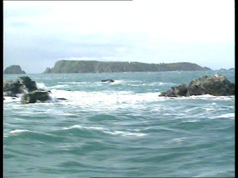 brecqhou barcley brothers haven cf english channel brecqhou island gv sea and island of brecqhou in distance as track rl airv island - english channel stock videos & royalty-free footage