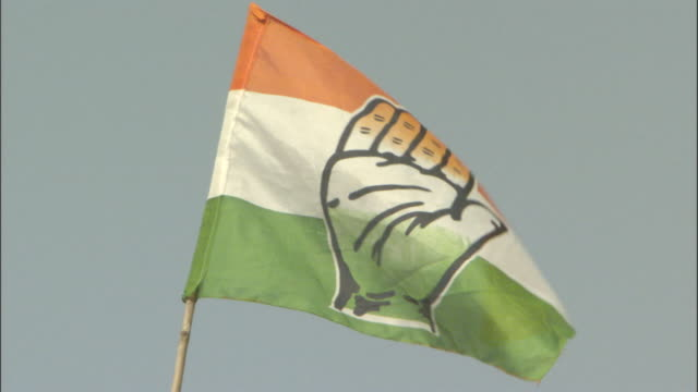 a breeze rustles a political flag in india. - indian politics stock videos & royalty-free footage