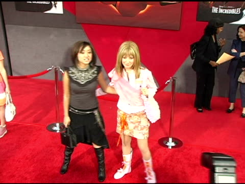 brenda song and ashley tisdale at the 'the incredibles' premiere at the el capitan theatre in hollywood california on october 25 2004 - brenda song stock videos & royalty-free footage