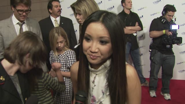 brenda song talks about why she loves jonas brothers shares her fashion must have and expresses her holiday wishes for the world at the jonas... - brenda song stock videos & royalty-free footage