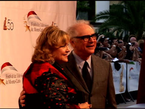 brenda vaccaro and barry levinson at the 50th monte carlo tv festival opening ceremony arrivals at monaco - ブレンダ ヴァッカロ点の映像素材/bロール
