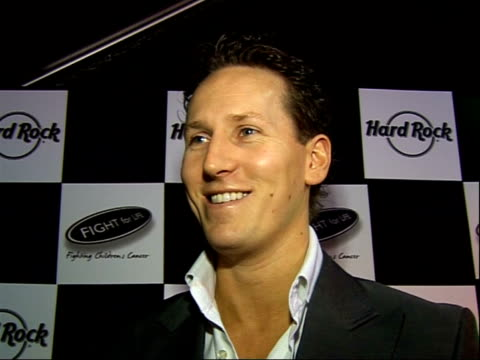 brendan cole turns on hard rock cafe christmas lights england london throughout** brendan cole interview sot discusses turning on lights/ dancing... - sergeant stock videos & royalty-free footage