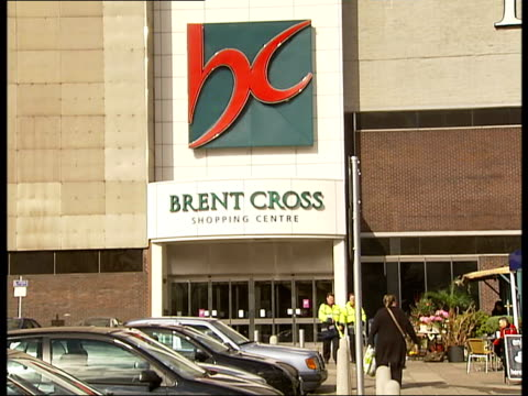 brent cross shopping centre and surrounding areas; ext sign and entrance to brent cross shopping centre / car park / people at cafe / traffic along... - trolley bus stock videos & royalty-free footage