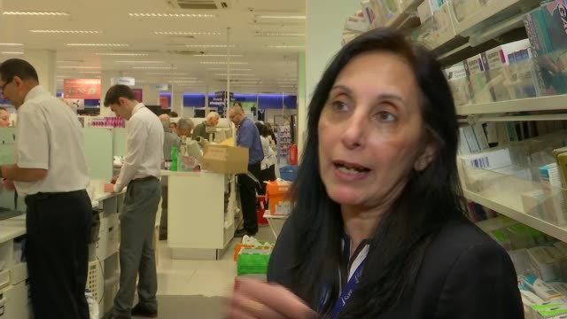 brent cross shopping centre celebrates 40 years of business; int reporter to camera pavitra joshi working behind counter in pharmacy joshi serving... - vanessa feltz stock videos & royalty-free footage