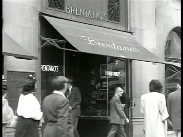 brentanos' book shop, new yorkers. int woman looking at books on table display, sign '...by authors of the new france.' books 'aurelien, aragon-poet... - 1946 stock videos & royalty-free footage