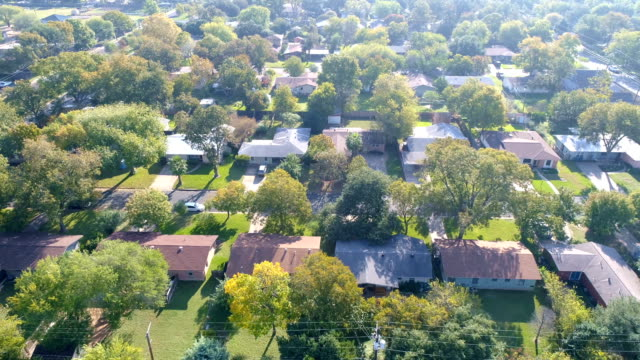 brentwood homes and real estate neighborhood of austin , texas drone aerial side pan - district stock videos & royalty-free footage