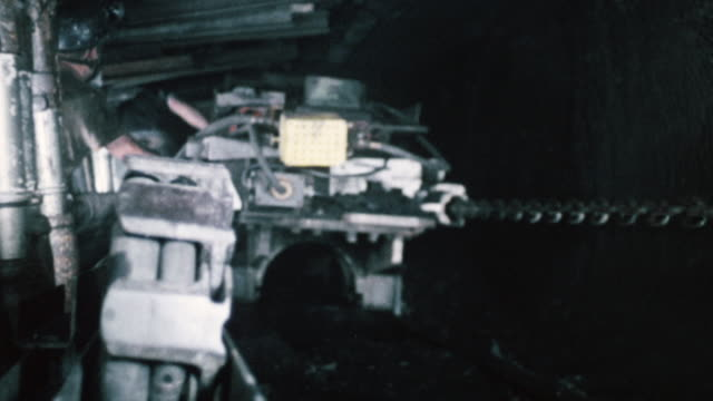 vídeos de stock, filmes e b-roll de montage bretby cable handler operating along tunnel / england, united kingdom - tunnel