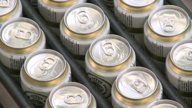 cu brewery of tins on conveyer belt in warsteiner ag / warstein, north rhine westphalia, germany - continuity stock videos & royalty-free footage