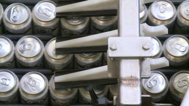 cu brewery of tins on conveyer belt in warsteiner ag / warstein, north rhine westphalia, germany - fließband stock-videos und b-roll-filmmaterial