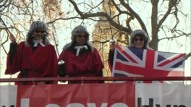 article 50 hearing protests and interviews england london ext antibrexit demonstrators on open top bus some dressed as judges probrexit placards held... - 2016 european union referendum stock videos & royalty-free footage