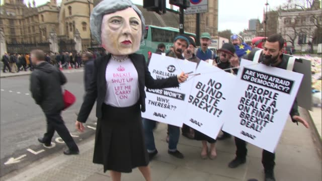 Parliament Square demonstration ENGLAND London Parliament Square EXT ProEU demonstrators in Parliament Square / demonstrator wearing large 'Theresa...