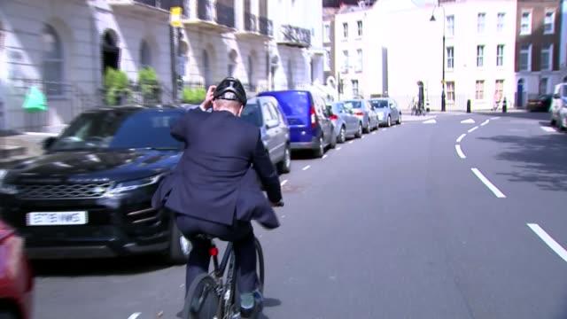 boris johnson affirms commitment to leaving eu on 31 october as brother jo johnson quits england london ext jo johnson mp riding away on bicycle - boris johnson stock-videos und b-roll-filmmaterial