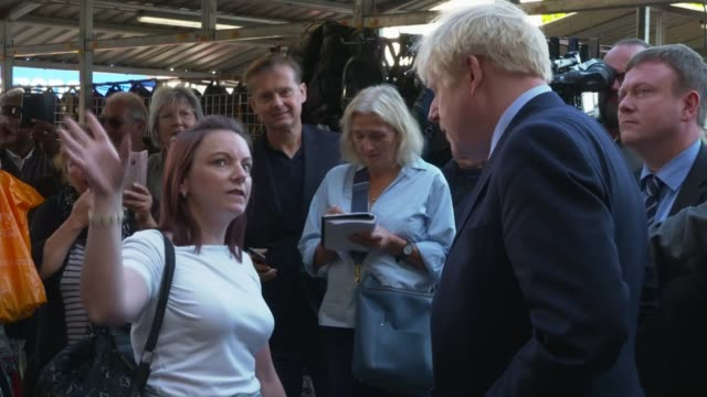 boris johnson 'cautiously optimistic' despite criticism england south yorkshire doncaster ext boris johnson mp out of car in town square and shaking... - cheek to cheek stock videos & royalty-free footage
