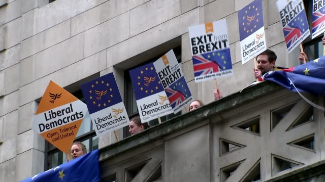 Boris Johnson delivers major speech London EXT Various of Liberal Democrat antiBrexit protesters demonstrating on balcony of building with EU flags...