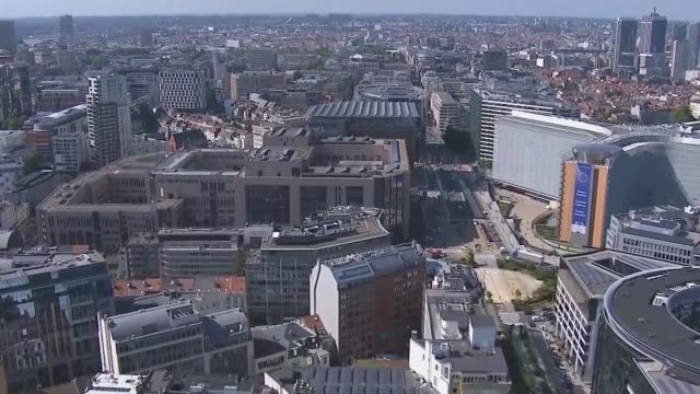 boris johnson secures deal: eu reaction; belgium: brussels: ext various air view city buildings around berlaymont building and europa building . - brussels capital region stock videos & royalty-free footage