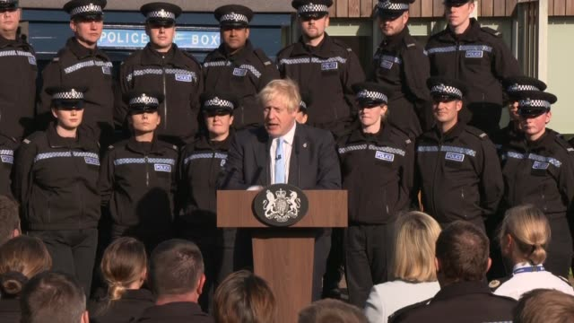 boris johnson speech in wakefield; england: west yorkshire: wakefield: ext boris johnson mp with priti patel mp and police officer out of building... - west yorkshire stock videos & royalty-free footage