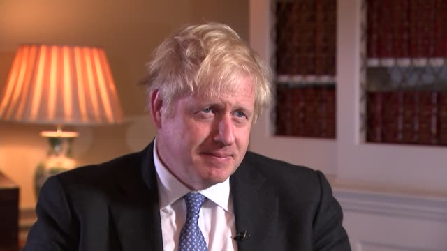 boris johnson struggling to resolve irish backstop issue as he prepares to meet eu leaders london uk boris johnson mp interview re irish backstop... - orbiting stock videos & royalty-free footage