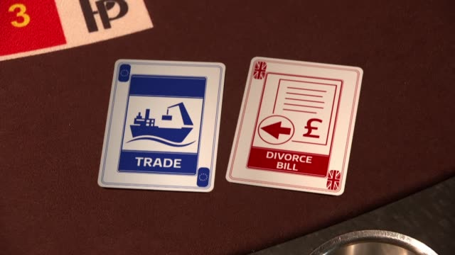 britain tirggers article 50: possible negotiating strategies; reporter to camera/ close shot of playing cards with 'trade' and 'divorce bill' /... - croupier stock videos & royalty-free footage