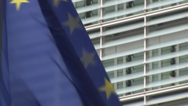 britain triggers article 50 belgium brussels gv european commission building and eu flag flying outside - europäische kommission stock-videos und b-roll-filmmaterial