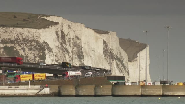 britain triggers article 50 kent dover ext traffic along near the white cliffs of dover dfds ferry and po ferries docked at port sign 'dover' pull... - dover kent stock-videos und b-roll-filmmaterial