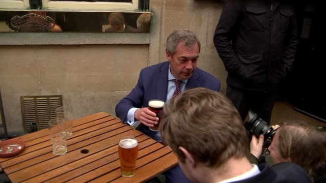 Britain triggers Article 50 Nigel Farage interview outside pub ENGLAND London Westminster EXT Nigel Farage MEP sits outside pub drinking pint of beer...