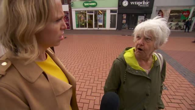 businesses ask what new deal will mean for them; england: west midlands: ext people along shopping street people along in town centre vox pops croft... - carrying stock videos & royalty-free footage
