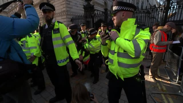 cabinet arrives at downing street to discuss draft withdrawal plan england london downing street ext protester being handcuffed by police officer... - protestor stock videos & royalty-free footage